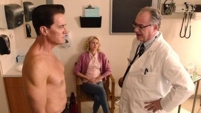 Dougie Jones stands in front of the doctor, with Janey-E sitting behind them.