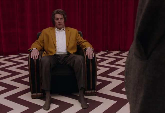 Dougie sits in the chair in the Red Room