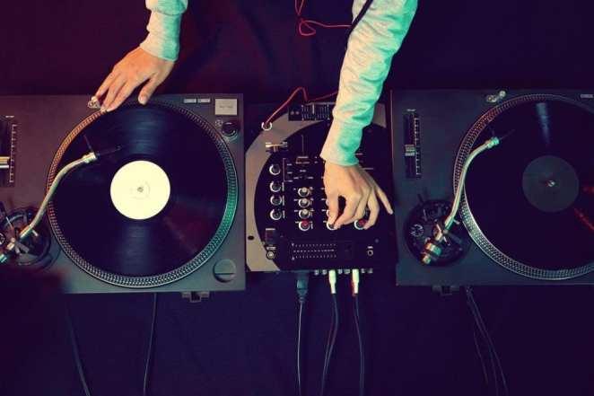 A DJ on Decks stock image