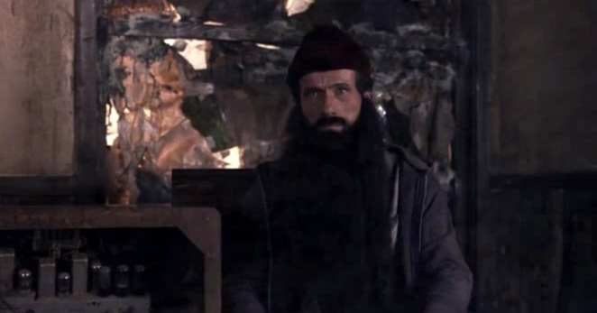 A woodsman sits next to an electric machine in FWWM