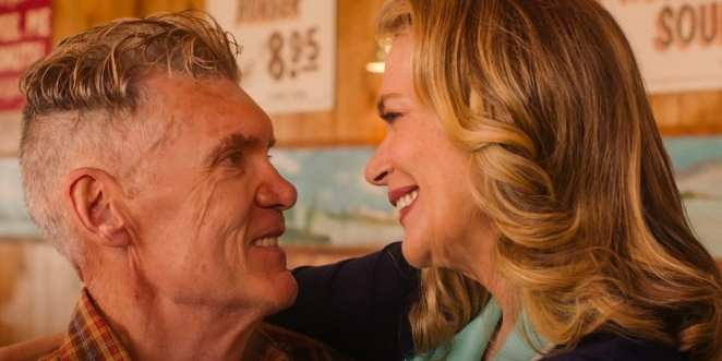 Ed and Norma embrace and smile at each other in the diner