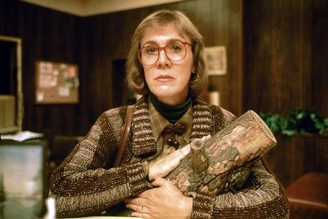 The log lady cradles her log in her arms