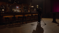 a man sweeping the floor of the bang bang bar