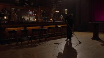 a man sweeping the floor of the bang bang bar