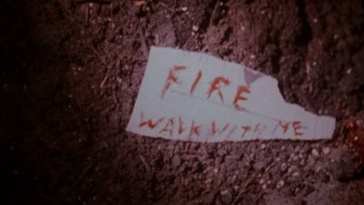 Fire Walk With Me written in blood on paper
