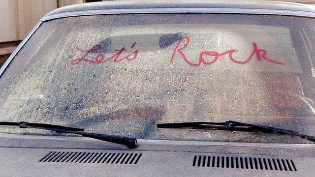 lets rock written in lipstick on a dirty car window