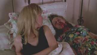 Laura Palmer finds a bleeding Annie next to her in bed