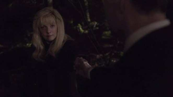 Dale Cooper takes the hand of Laura Palmer, saving her life
