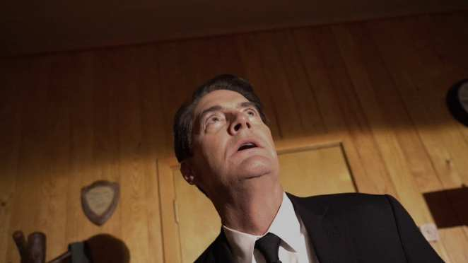 Agent Cooper looks frightened as he looks up at BOB