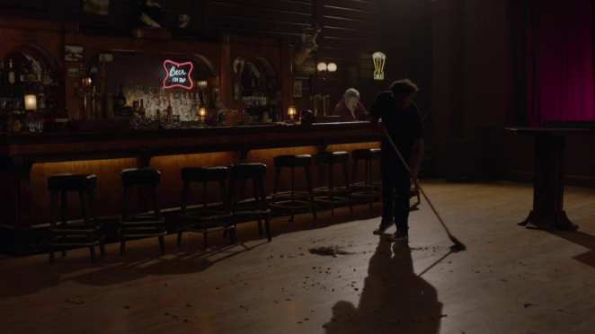 a man sweeps the roadhouse floor to the tune of Green Onions