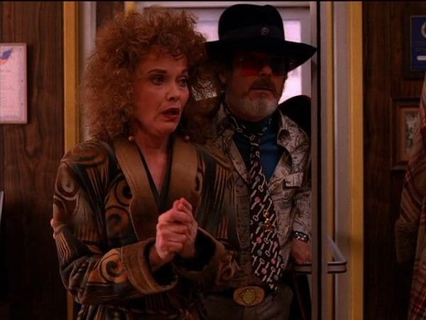 Dr Jacoby leads Sarah Palmer to the Diner to give Briggs a message