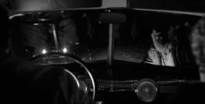 a woodsman peers into a car window in Twin Peaks Part 8