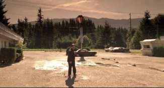 Leland walks away from the Red Diamond Motel