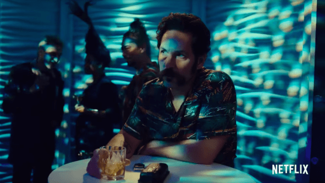 Paul Rudd as Cactus in Mute, drinking whiskey in a club