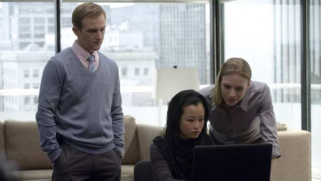 Jamie Wright and Gwen Eaton look at a laptop screen in The Killing