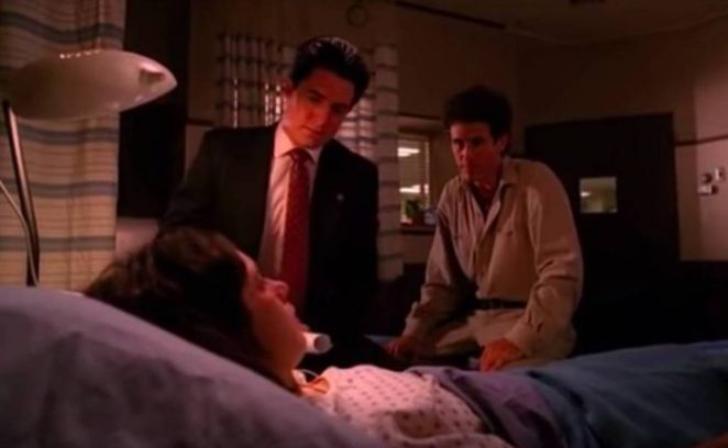 Cooper adjusts his stool at the bedside of Ronette
