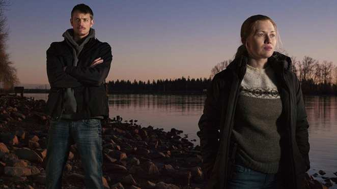 Sarah Linden and Stephen Holder in The Killing standing next to a lake at twilight