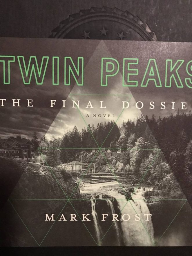 The front image of the Final Dossier dust cover show an image of the Great Northern's waterfall framed in the center of a lighter triangle.
