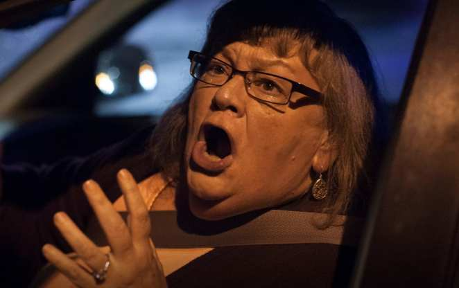 a woman screaming from inside her car