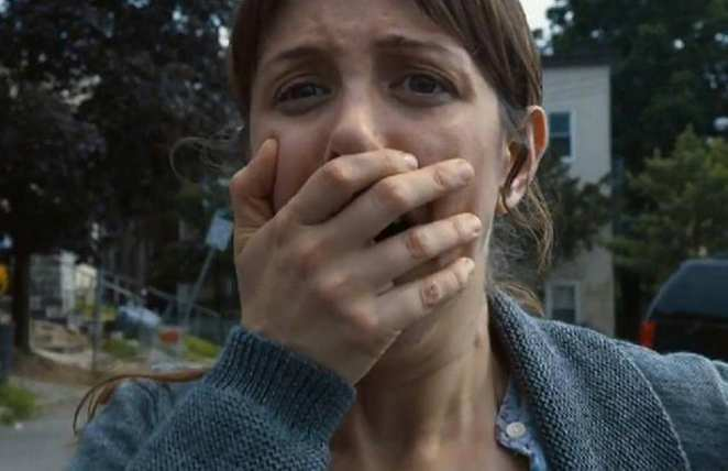 Sam's mother puts her hand over her mouth as the Departure occurs