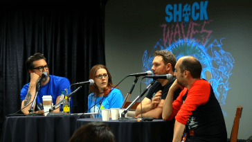 Shock Waves podcast crew at a convention