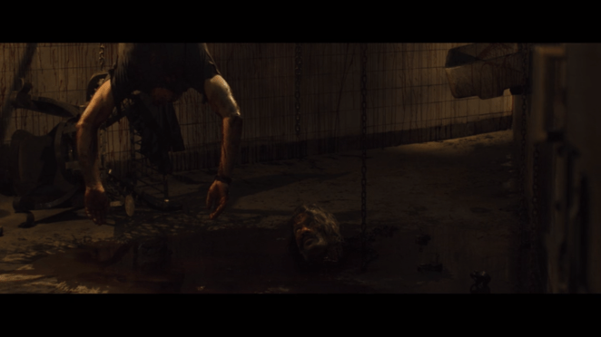 A headless corpse dangles from the ceiling