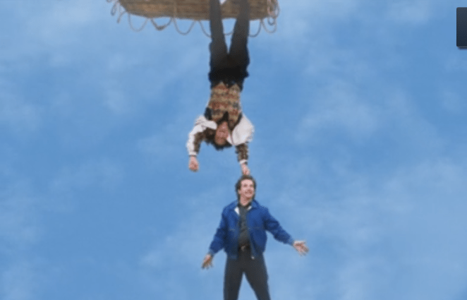 Balki holds Larry by the hair from the bottom of a hot air balloon in the finale of Perfect Strangers