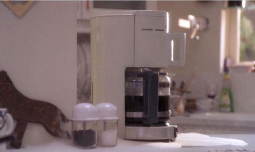 Black coffee representing Black Magic in The Believers, 1987