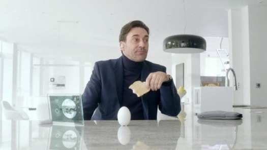 "Matt (Jon Hamm) eats toast while giving a cookie a timeout in Black Mirror's ""White Christmas"""