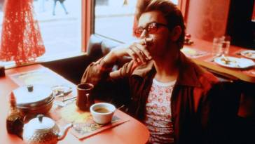 River Phoenix in My Own Private Idaho sitting in a diner smoking and drinking coffee