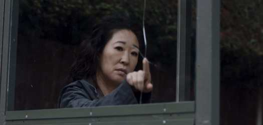 Eve Polastri (Sandra Oh) from Killing Eve contemplates a crack in a bus shelter before smashing the glass