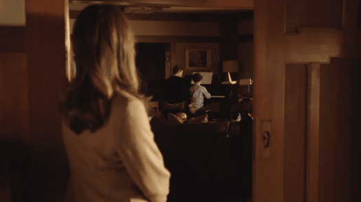 """Katherine Ford (Diane Lane) looks on as David Patton (Andrew Rannells) questionably places his hand at the end of The Romanoffs """"Bright and High Circle"""""""