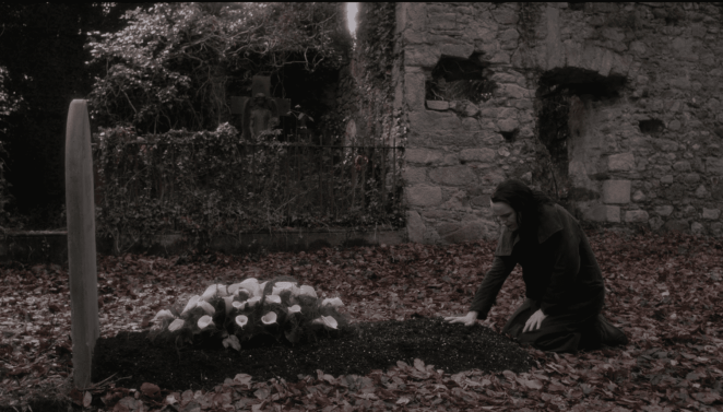 John Clare (Rory Kinnear) kneels at Vanessa's grave in the season three finale of Penny Dreadful