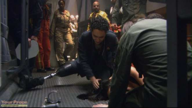 A hobbled Lt. Gaeta (Alessandro Juliani) finds Lt. Dualla (Kandyse McClure) after her suicide in Battlestar Galactica