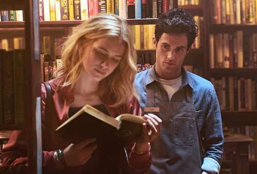 Joe eyes Beck while she reads a book in Lifetime's You