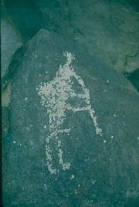 Image of the kokopelli carved into a rock