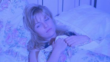 Laura Palmer in bed dreaming bathed in blue light