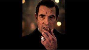 Dracula puts his hand to his mouth