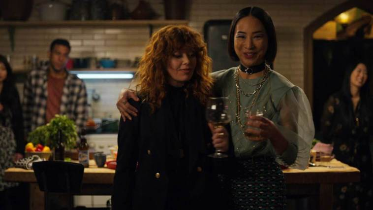 Nadia and best friend Maxine (Greta Lee) at Maxine's apartment and Nadia's never-ending birthday party
