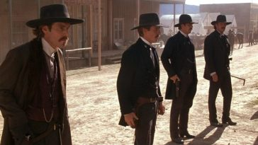 A gunslinger looks straight ahead suspiciously