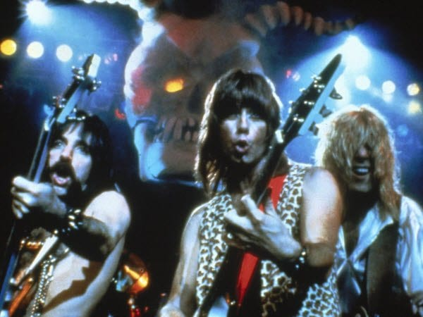 Spinal Tap gives their audience their best metal poses.