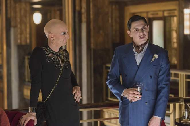 Denis O' Hare as Elizabeth Taylor and Evan Peters as James March in American Horror Story: Hotel