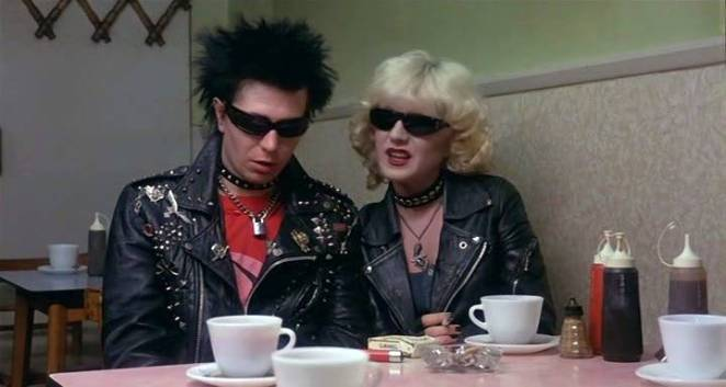 Sid and Nancy try to appear sober in the light of the diner.