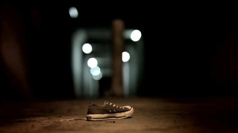 A lone sneaker at the entrance to the tunnel in Absentia