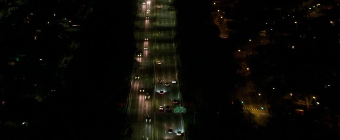 The Safdies pull back the camera, showing a birds-eye view of a freeway in New York City as Connie continues his night-long odyssey.
