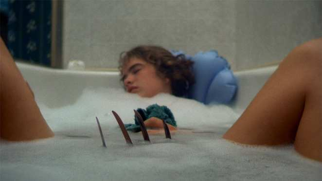 Nancy (Heather Langenkamp) makes the fatal mistake of falling asleep in the bath with Krueger on the loose in her dreams.