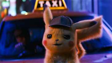 Pikachu pictued in front of a taxi in Detective Pikachu
