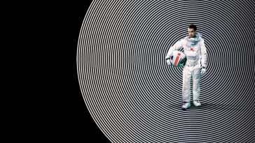 Moon poster image, Sam Rockwell holds his space helmet under his arm