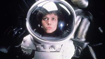 Ripley looks on in a spacesuit in Alien