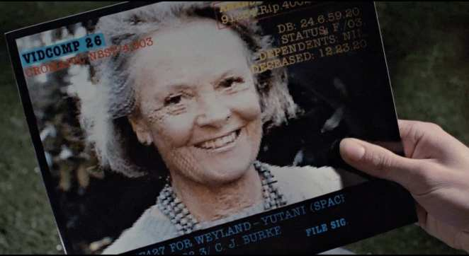 Ripley looks at a photo of her daughter Amanda in Aliens
